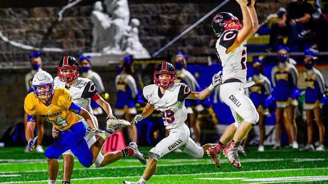 """Sophomore linebacker Corbin Rodenberg of the 2020 Chillicothe (Mo.) HS football Hornets uses a good """"drop"""" to undercut a Kansas City: St. Pius X pass route and intercept a second-period pass intended for SPX senior star David Deters at the CHS 35-yard line during Friday's (Sept. 25) game at Kansas City. After falling behind 35-0 early in the second half, Chillicothe roared back to make the outcome in doubt late before losing 42-27."""
