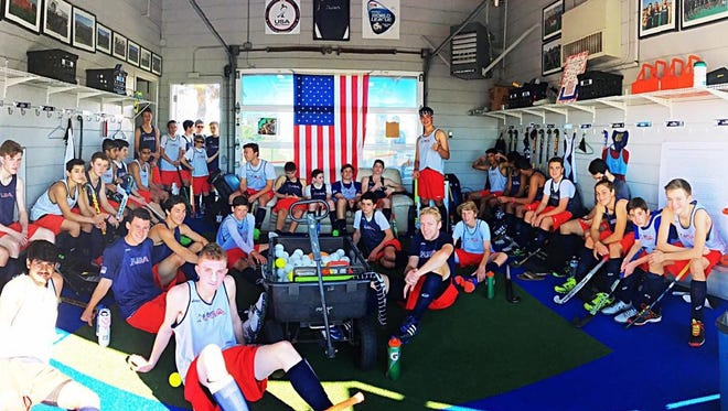 Phile Govaert (front row, far right) in Chula Vista, California with U.S. Junior Men's field hockey players