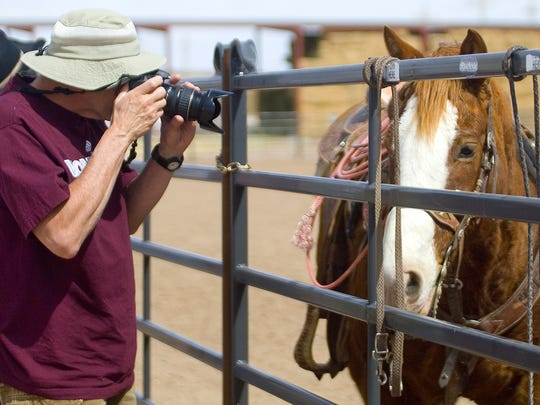 Bill Witmer, of Lakewood, Colo., takes photos of a horse during Cowboy Days at the New Mexico Farm & Ranch Heritage Museum.
