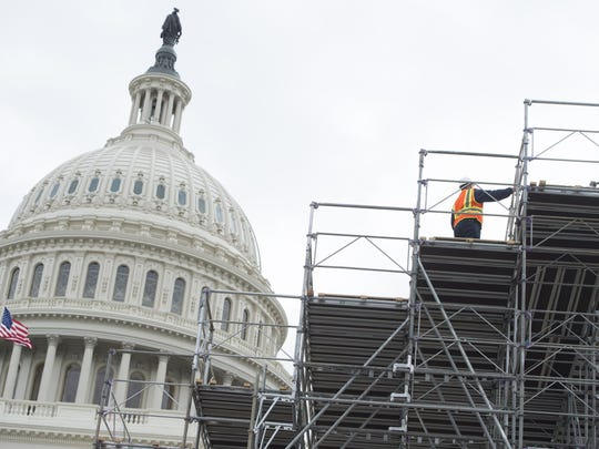 Workers build portions of the inaugural platform for President-elect Donald Trump at the Capitol on Dec. 8, 2016.