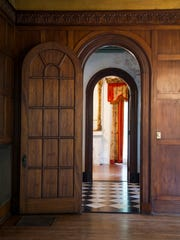 "Pocket doors, arched doorways and elaborate moldings put the ""grand"" in grand parlor."
