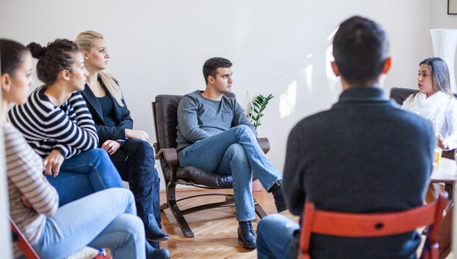 Woman speaking in group therapy session. Group therapy session.