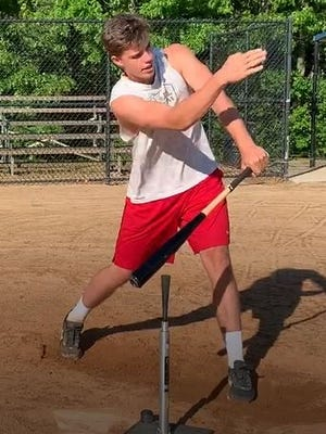 Hunter Dean shows how the positioning of a batting tee can help a batter learn to hit to all fields.