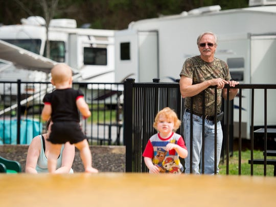Danny Beck from August, Ga., watches his grandchildren play on a trampoline at Camp Riverslanding campground in Pigeon Forge on Tuesday, April 3, 2018. The campground is celebrating its 50th anniversary with specials.