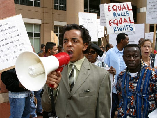 Jarrett Maupin chants in front of Phoenix City Hall in 2005 with dozens of taxi drivers who parked in the middle of Washington Street to protest.