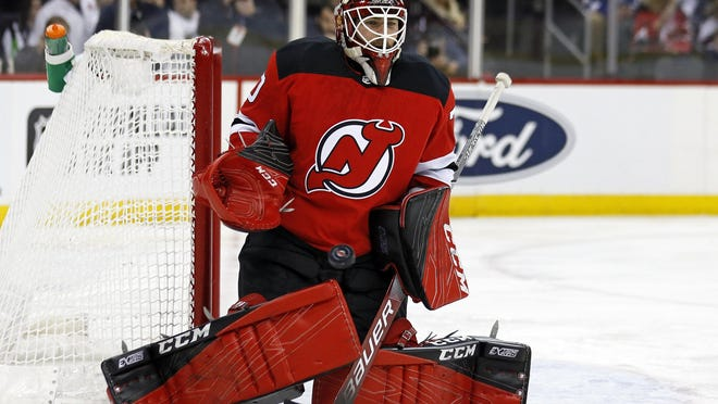 Devils goaltender Louis Domingue makes a save against the Lightning during the first period.