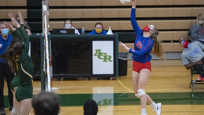 West Henderson's Kera Putnam spikes the ball against A.C. Reynolds during their match Friday at Reynolds High School.