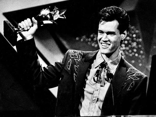 Randy Travis shows off one of the five awards he won at the TNN Viewer's Choice Awards show in Nashville April 26, 1988.