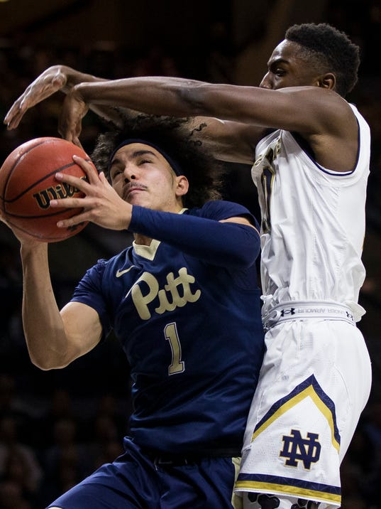 Pittsburgh's Parker Stewart (1) goes up for a shot with pressure from Notre Dame's T.J. Gibbs during the first half of an NCAA college basketball game Wednesday, Feb. 28, 2018, in South Bend, Ind. (AP Photo/Robert Franklin)