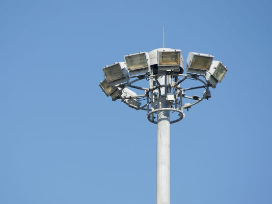 Lamps on high pole with blue sky