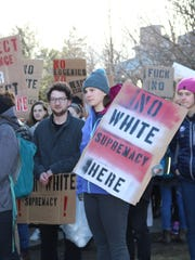 Middlebury College protesters wait in line on March