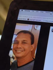 A publicly posted Facebook photo of Airport Police Officer Vincent R.Q. Castro is shown on a computer screen.
