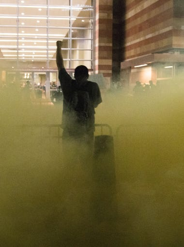 Protesters were tear gas by Phoenix Police outside Phoenix Convention Center. Nick Oza/The Republic