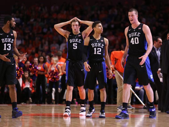Duke Blue Devils players look disenchanted during a