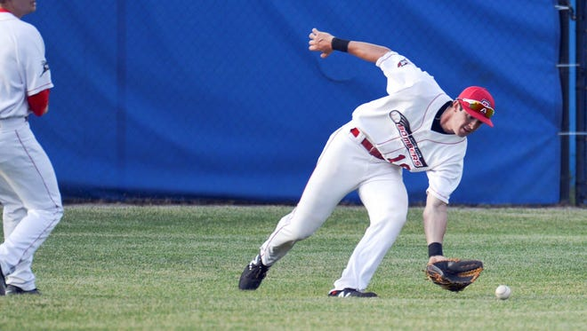 Bombers center fielder Nick Walker fields a ground ball early in Tuesday night's match up against the Madison Mallards.
