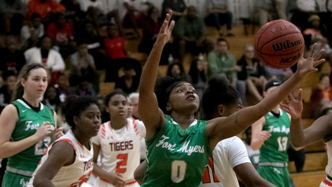 Bethany Brunson Fort Myers gets a rebound against Dunbar in the girls basketball district championship on Friday, Feb. 9, 2018, in Fort Myers.