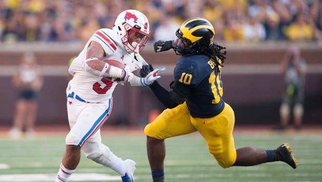 Michigan linebacker Devin Bush catches SMU running back Xavier Jones for an open-field tackle in the second half.