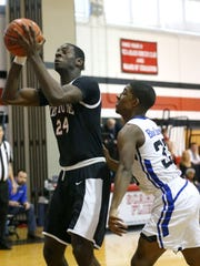 Jared Kimbrough (24) of Neptune goes to the basket