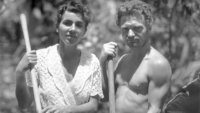 Dore Strauch and Friedrich Ritter holding tools in their garden at Friedo. Floreana Island, Galapagos. Circa 1932.