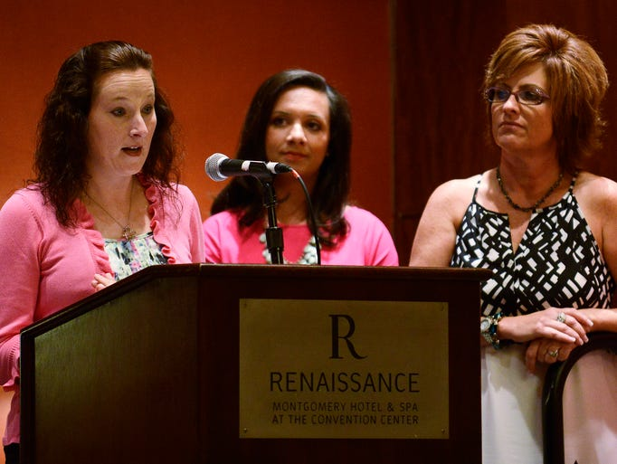 Cancer survivor Joannie Kelli, left, talks about her experiences as Melissa Johnson, center, and Leanne Thompson look on during the Kick-Off for Making Strides Against Breast Cancer at the Renaissance Hotel and Spa at the Convention Center in Montgomery, Ala. on Tuesday August 25, 2014.