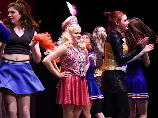 """Elle Woods, played by Lauren Davis, with the help of marching band and cheerleaders gets into Harvard Law School during """"Legally Blonde"""" Thursday, May 5, at the Rocori High School in Cold Spring."""