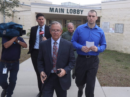 Punta Gorda police officer Lee Coel Is escorted out of the Charlotte County Jail on Wednesday, Feb. 22, 2017, with his attorney Jerry Berry after posting bond. He was charged with felony manslaughter in the death of Mary Knowlton.