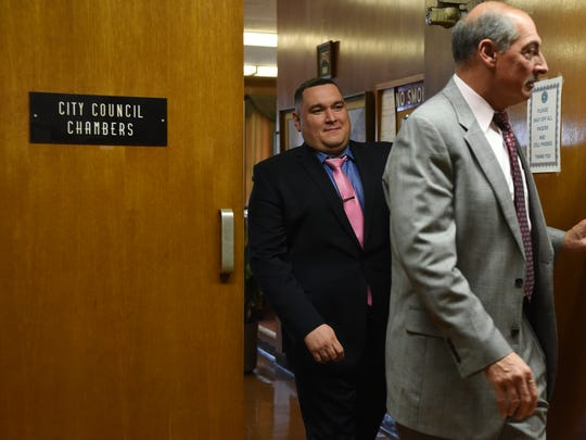 Suspended Hackensack Police Officer Victor Vazquez, left, leaves the City Council chambers during a lunch break in a November hearing to determine punishment stemming from his participation in an illegal search at an apartment on Prospect Avenue in December 2016.