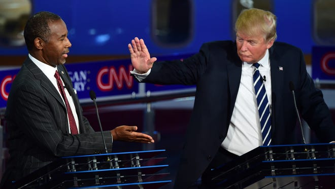 Republican presidential hopefuls  Ben Carson and Donald Trump participate in the Republican Presidential Debate at the Ronald Reagan Presidential Library in Simi Valley, California on Thursday.