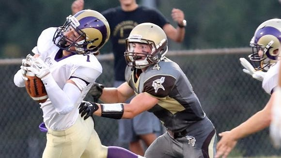 Clarkstown North's Rhys Farrell-Bryan (7) intercepts