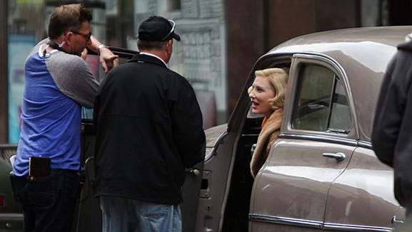 Cate Blanchett talks to producers from a 1949 Packard outside the former Shillito's department store.