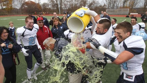 Westlake coach John Castellano gets doused with Gatorade after his team beat Nanuet 6-0 to win the Section 1 Class B championship at Somers High School on Nov. 7, 2015.