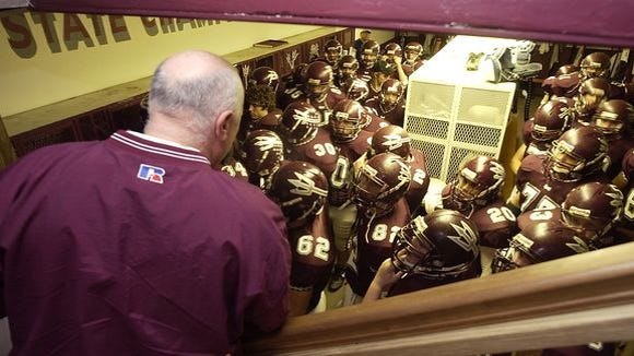 Former Swain County coach Rod White addresses his football players in 2004.