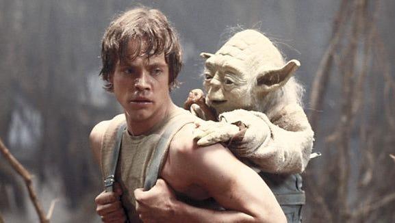 "Luke Skywalker carries Yoda on his back during Jedi training in ""Star Wars Episode V: The Empire Strikes Back."""