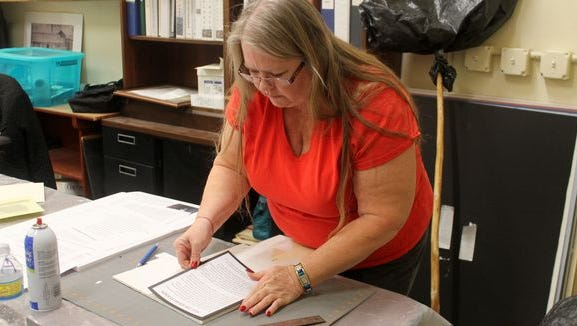 Tularosa Basin Historical Society Treasurer Debra Lewandowski works on labels behind the scenes at the new Tularosa Basin Museum of Hsitory on 10th Street and White Sands Boulevard. The grand opening is set for Jan. 16.