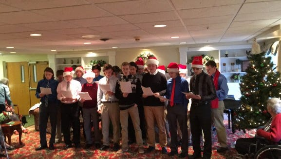 Brockport High School varsity hockey players visit Emeritus at Landing of Brockport on Dec. 20, 2015.