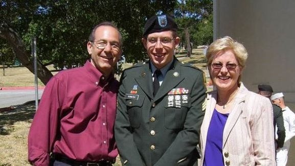 Sgt. Daniel Somers, with his parents, Howard and Jean. He became a casualty of war...when he got home.