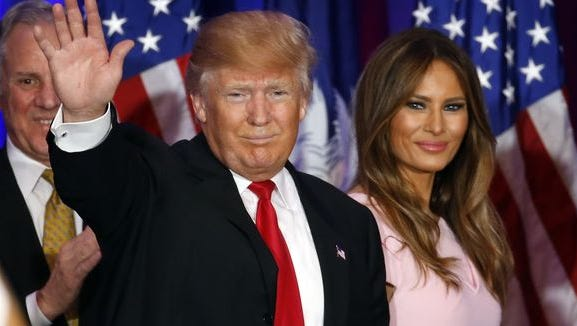 Donald Trump waves with his wife, Melania, at a rally in Spartanburg, S.C., on Feb. 20, 2016.