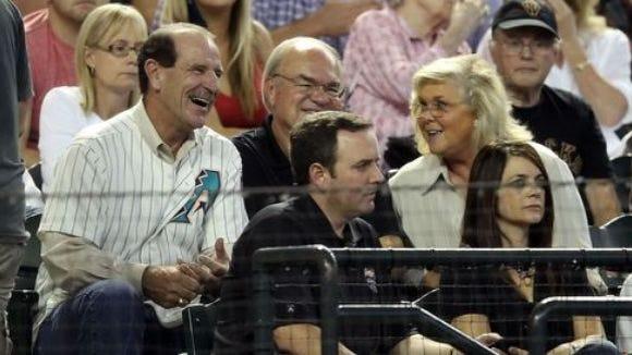 Diamondbacks analyst Bob Brenly (l) shown sitting next to owner Ken Kendrick and his wife Randy.