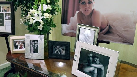 Photos are displayed at Jill Conley's visitation in February.
