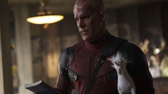 """Ryan Reynolds as Deadpool in the a scene from """"Deadpool."""""""