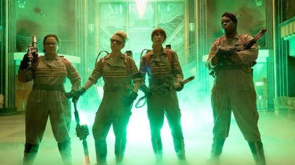 "Melissa McCarthy, from left, Kate McKinnon, Kristen Wiig and Leslie Jones in a scene from ""Ghostbusters."""