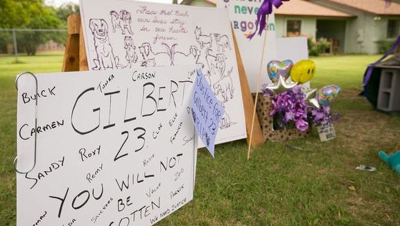 A makeshift memorial after at the boarding facility where 23 dogs died