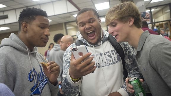 Dytarious Johnson, center, attended a prep school before ending up at Eastern Illinois