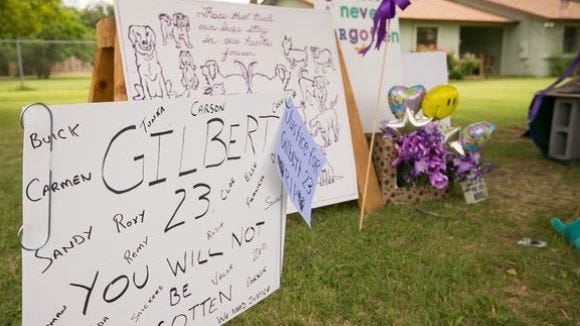 A makeshift memorial outside the site where 23 dogs died.