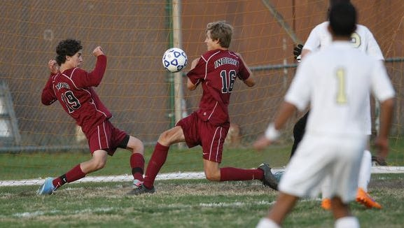 Nyack's Will Ramos (19) left and Jamie Schutt (16) work to clear the ball from in front of the goal during a boys soccer game against Nanuet at Nanuet High School on Wednesday, Oct. 21, 2015.