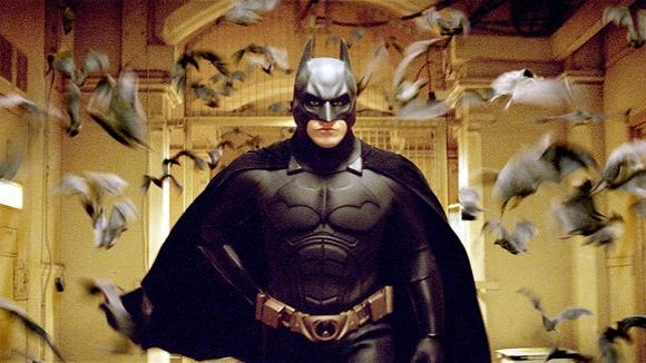 "Christian Bale stars as Batman in ""Batman Begins"""