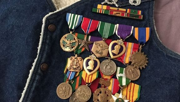 D.J. Bland's military medals still pinned to the denim vest he regularly wore.