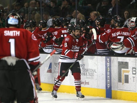 St. Cloud State forward Nick Poehling (8) celebrates his goal against University of North Dakota in the first period of Saturday's NCHC Quarterfinals game two between the Fighting Hawks and Huskies, March 11, 2017 at the Ralph Engelstad Arena in Grand Forks, N.D. (Jesse Trelstad/Grand Forks Herald)