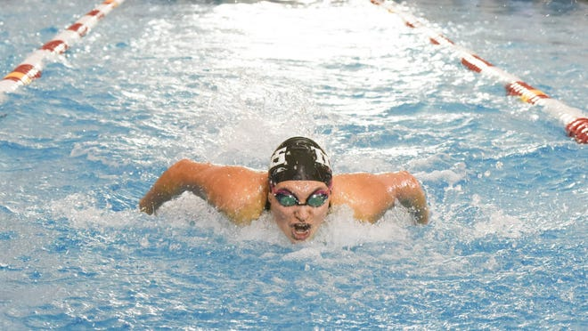 West Salem senior Mackenzie Rumrill won state championships in the 200 IM and 100 butterfly at the OSAA Class 6A state championships on Saturday, Feb. 21, 2015.