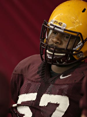Arizona State offensive lineman Evan Goodman rests between reps during spring football practice on Arizona State University Tempe campus on March, 19, 2015.